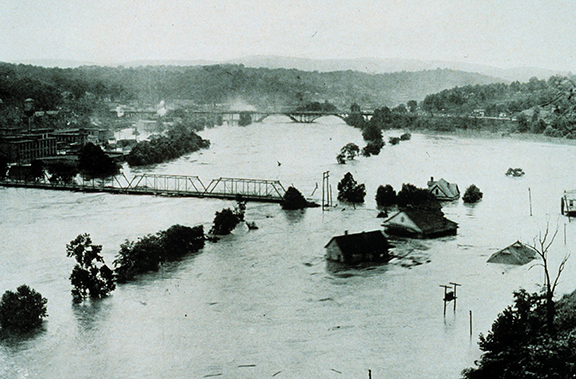 A river claimed the remaining railroad span in Asheville shortly after this photo was taken in 1916.Photograph by Steve Nicklas, NOS, NGS; courtesy of National Oceanic and Atmospheric Administration/Department of Commerce