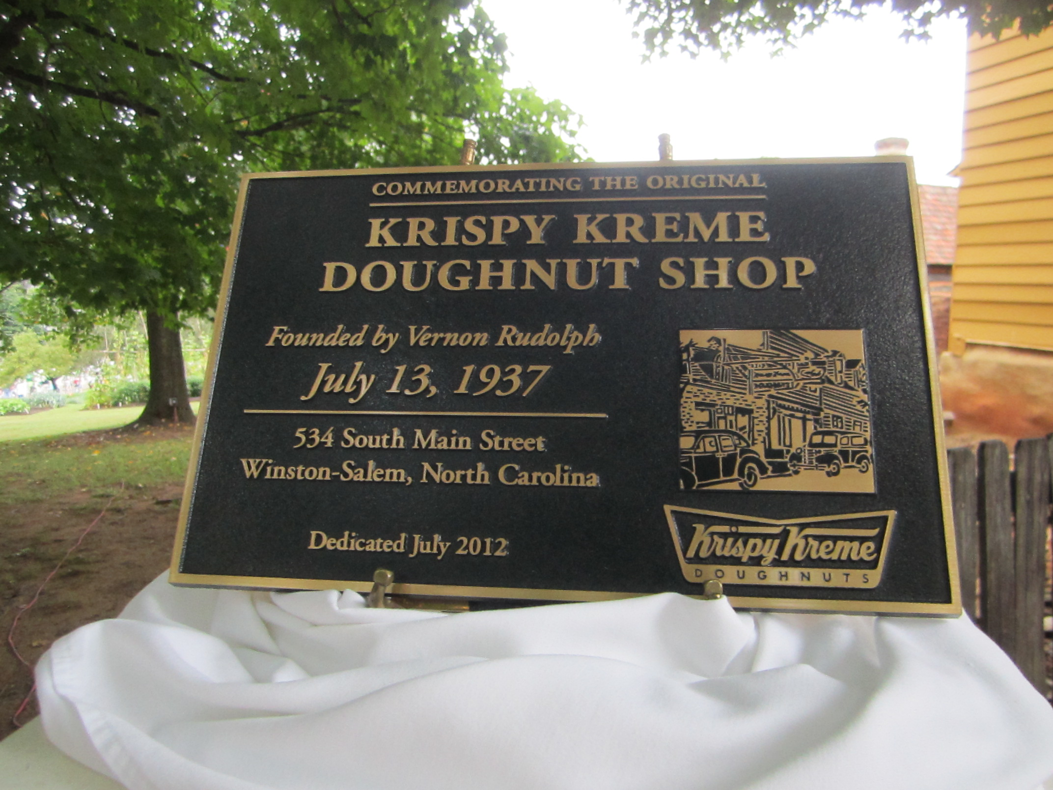 Krispy Kreme Historic plaque at 75th anniversary celebration Photo by Julie Thomson