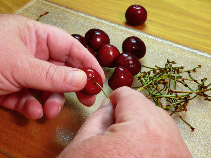 Remove the stems from the cherries.  Yes, you have to do this one at a time.
