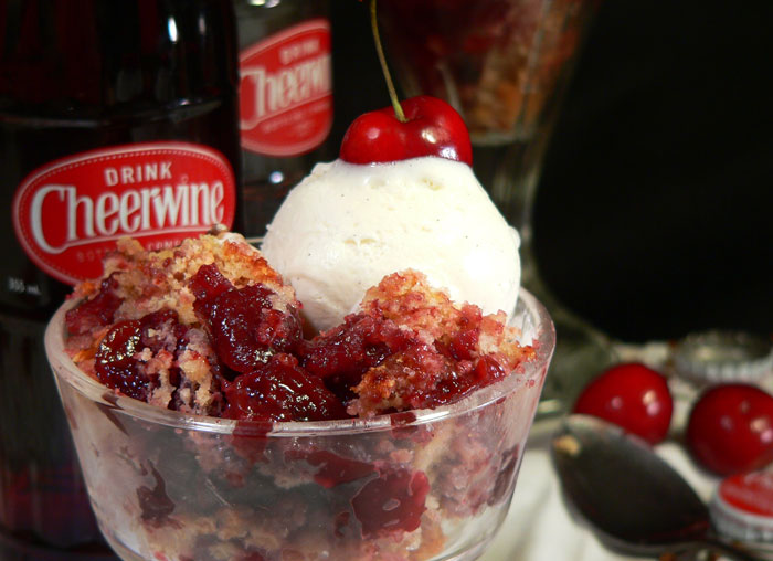 Serve a generous portion of your warm Cheerwine cherry cobbler with a scoop of vanilla ice cream. Enjoy!