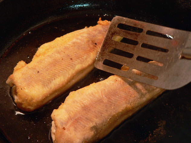 Don't be afraid to flip them several times during the frying process. You certainly don't want them to burn and by flipping them every couple of minutes, you can keep a close eye on them. If the fish start to curl or bow up a bit, the pan is probably too hot. Reduce the temperature and let them continue to cook.