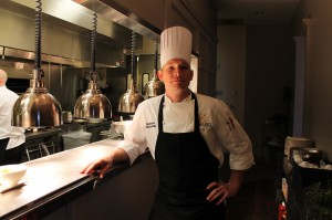 David Moore, chef de cuisine at the Ballantyne Hotel & Lodge in Charlotte, stands in the kitchen of Gallery restaurant at the hotel.