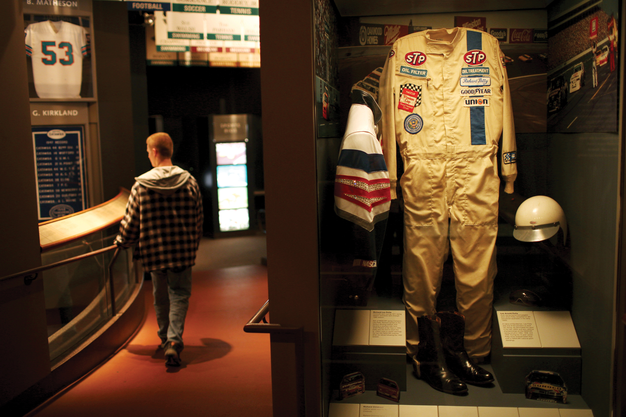 Richard Lee Petty's coveralls from 1971 stand proudly next to his car.