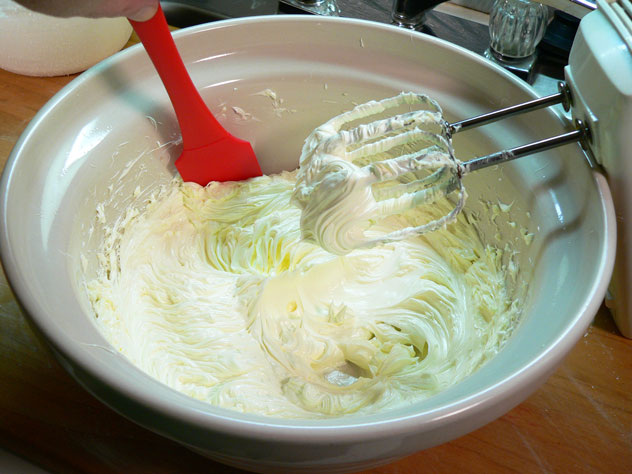 Using a mixer, beat the butter until it's light and fluffy. At first, my little hand mixer didn't want to do this for me, but after the butter warmed up a little, we moved forward.