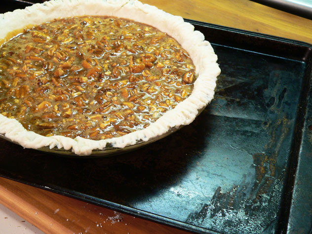 To be safe, place the filled pie on a baking sheet.  This is in case the pie were to bubble over once it starts baking.  Just makes cleanup quick and easy, and keeps you from having to scrub down the bottom of the oven for awhile.  You can thank me later.