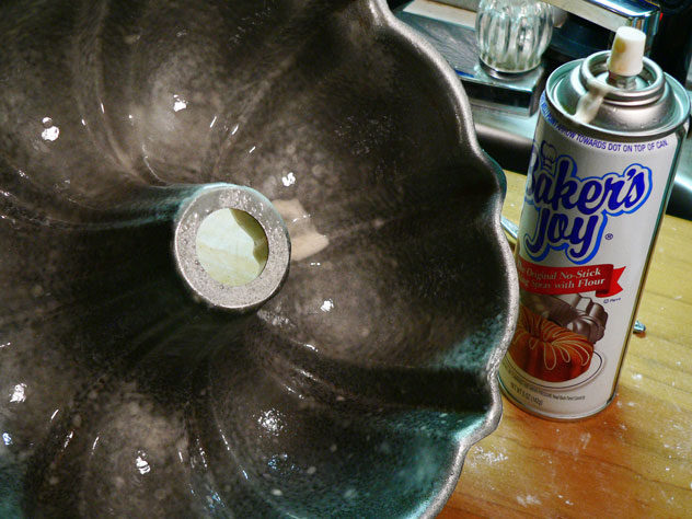 """Use a """"Baking Spray"""" of choice, and spray the inside of your pan. I wanted to use loaf pans but only had one on hand. I found my Bundt Pan and used it instead. You could use Butter to grease the pan, then flour it, but the baking spray helps get into all the edges of a Bundt Pan fairly easily. Just remember, Baking Spray contains flour already. A regular cooking spray does not and will not work by itself for this recipe."""