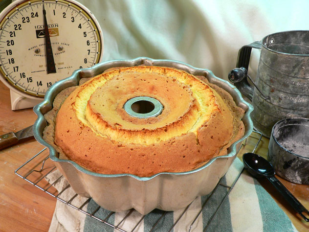 """Set the cake on a wire rack and let it cool for 20 minutes before you try to remove it from the pan. As you can see, it rose a good bit once it baked. Don't you just love that """"crack"""" that runs around the entire cake. This is normal and expected. It would have looked great in a loaf pan too. Now, will it come OUT of the pan OK?"""