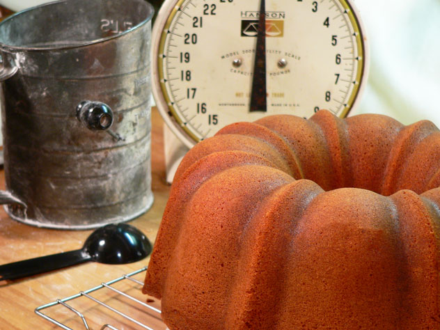 Beautiful! After 20 minutes, place the wire rack on top of the cake. Gently hold the rack against the cake and flip it all over. Set the rack and pan down on your counter. If the cake doesn't fall right out, gently tap around the bottom of the cake pan. You'll hear a slight change in the tone of your tapping, once the cake falls out. I did have to tap mine a time or two, and held my breath as I lifted the cake pan away.