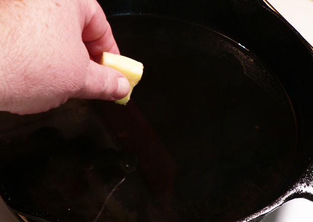 When the lard has melted and is getting close to frying temperature, carefully add the butter.