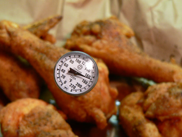 According to the US Dept. of Agriculture, (USDA) chicken is fully cooked and safe to eat when it reaches an internal temperature of 165°F. If you don't already have one, I highly suggest you pick up a thermometer on your next shopping trip. They're extremely handy in the kitchen.