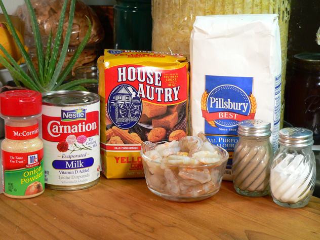 Shrimp Po' Boy Sandwich: You'll need these ingredients. The above ingredients will be used to make the seafood breader, and to fry the shrimp. You'll need some type of oil for frying, and of course a loaf of french bread. Toppings to