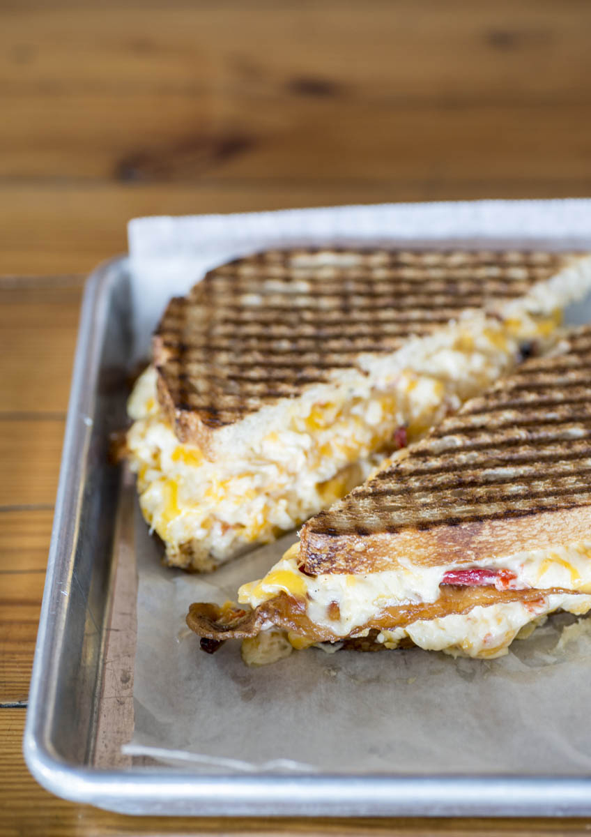 Where do you get yours? Musten & Crutchfield in Kernersville? Conrad & Hinkle in Lexington? Dozens of pimento-cheese purveyors in North Carolina are all waiting for you to try theirs, preferably between two slices of toasted bread. • Photo by Lissa Gotwals.