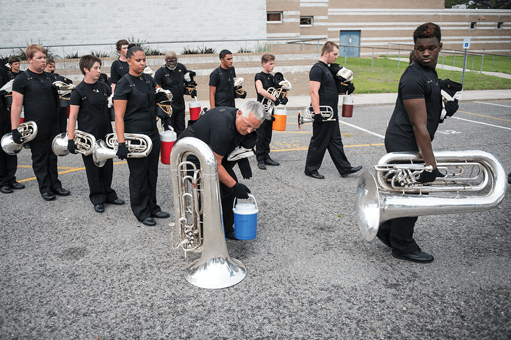 Practice makes perfect, and wins competitions. At Cape Fear High School, musicians in Carolina Gold's brass section head to the field with horns in one hand and water jugs in the other, drum major Kennith Watts Jr. leads a mid-afternoon rehearsal, and the day ends with more practice.