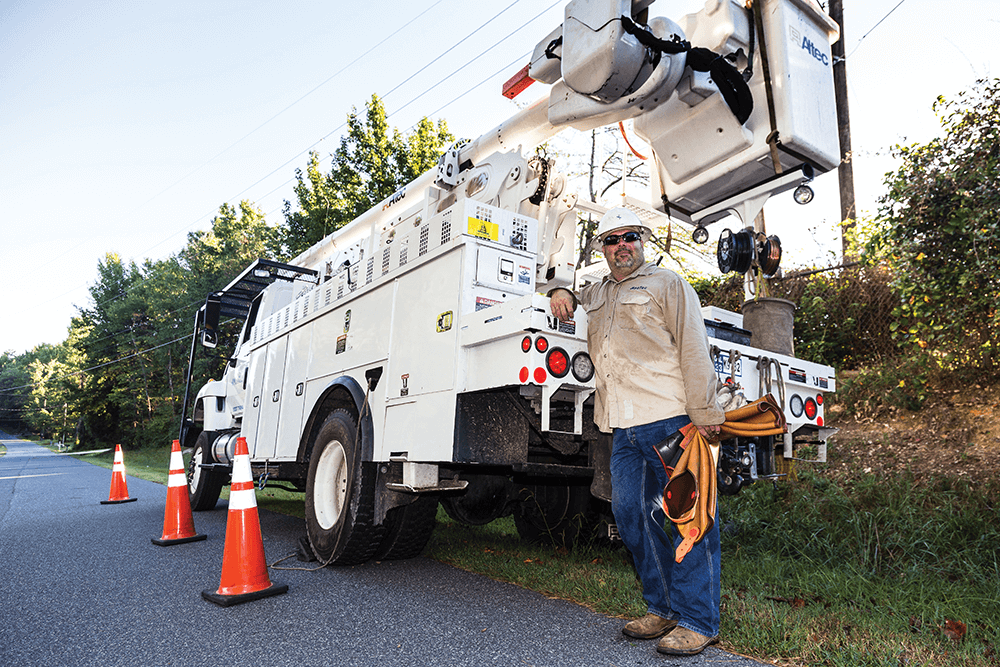 Today, Scott Faulkner carries on the work done by early linemen, but with modern gear and, fortunately, many more safety regulations in place. • Photo by Julian Charles.