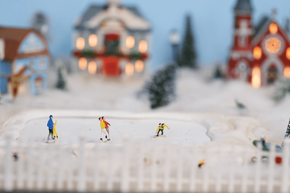 Ice skaters cruise magically (OK, magnetically) across a winter-wonderland Christmas scene complete with lit churches and decorated homes.