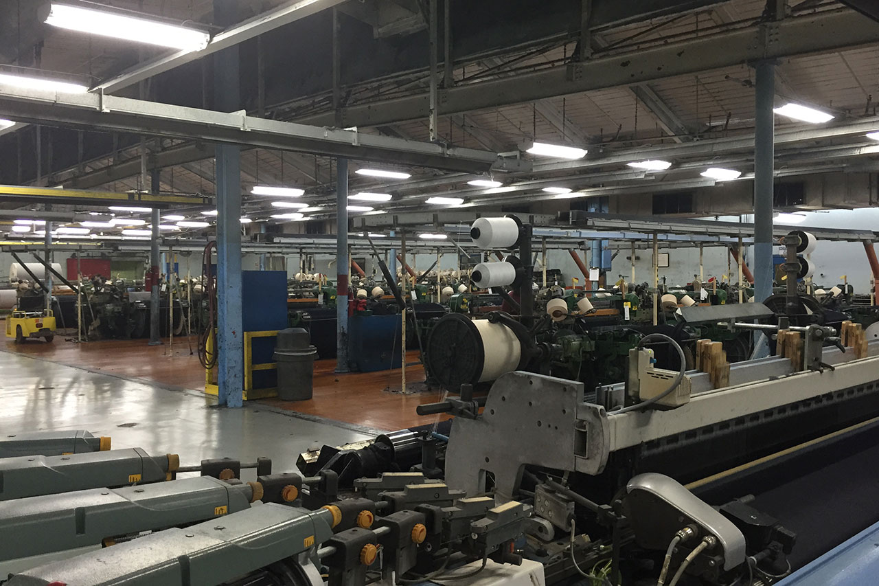 Inside Cone Mills White Oak Plant in Greensboro, where they make denim in the same way they've made it since the 1940s.