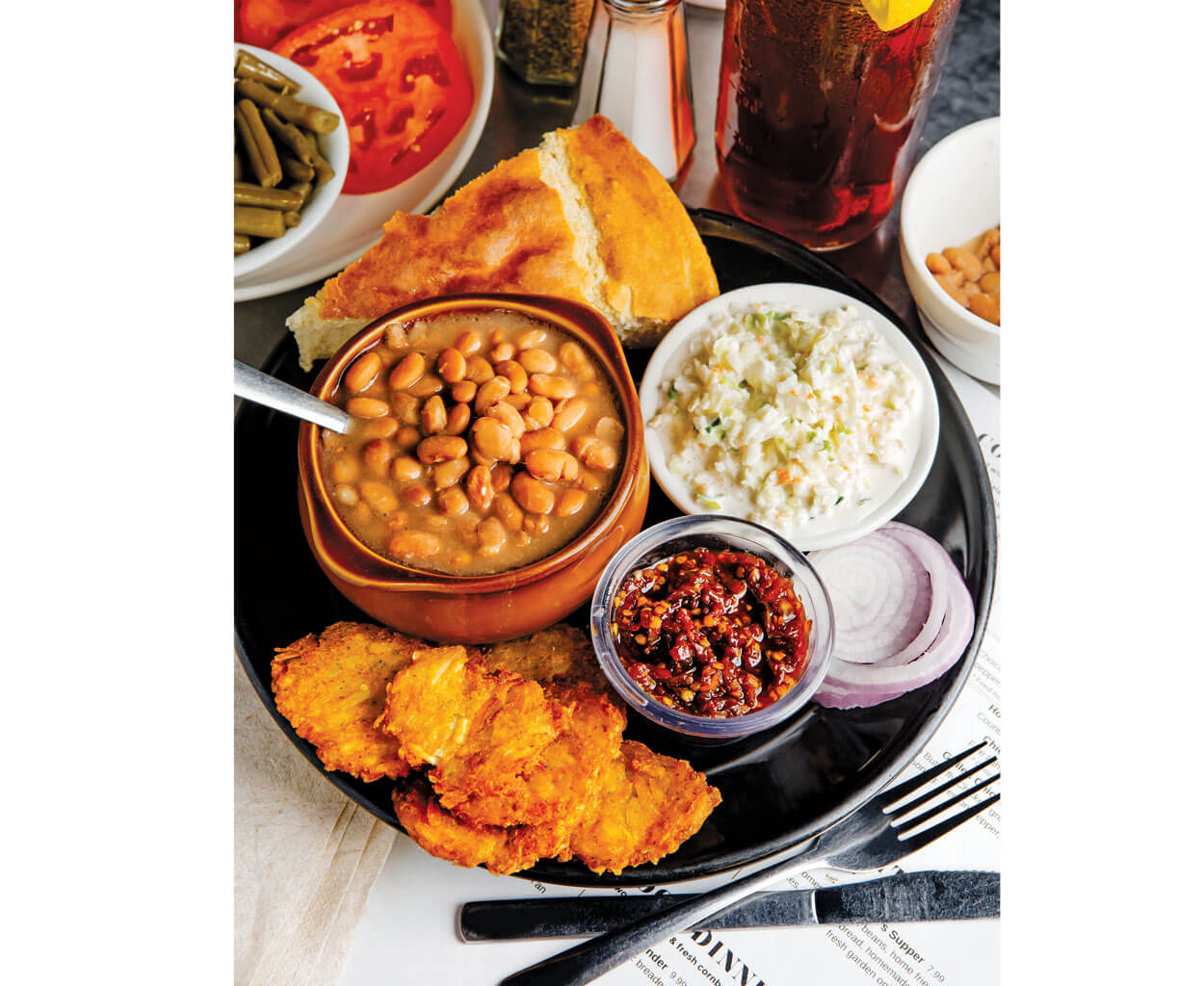 "One of the most popular dishes at Genia Hayes Peterson's diner is the ""Poorman's Supper"": pinto beans, cornbread, coleslaw, and potato cakes, crowned with spicy pepper relish."